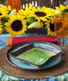Design by Julie Shaw, JS Designs   Photography by Nancy Nolan   At Home in Arkansas   http://www.athomearkansas.com/article/lakeside-tropics# #outdoor #patios #tabletop #centerpiece