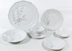 "Lot 322: Mitterteich ""Fragrance"" China Service; Silver rim; including (12) dinner plates, (10) coffee cups and saucers, (11) bread plates, (10) dessert plates, (11) soup bowls, (11) fruit bowls and a sugar bowl lid"