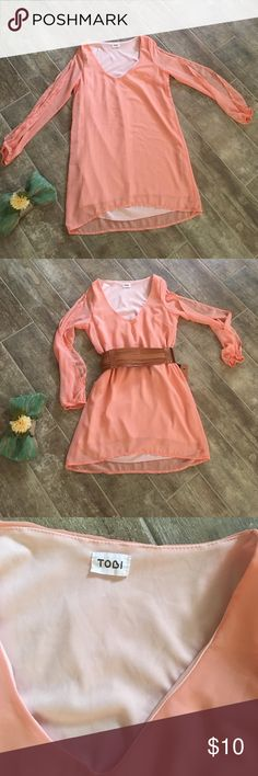 """Country Boho Vibe Mini Dress or Tunic Beautiful peachy coral colored mini dress or tunic top.  Bought from a fellow posher in great condition.  Never worn by me other than to try it on.  Long sleeves with slits all the way down the arms.  Slight high low hem.  Attached lining.  Bust: 18"""".(no give in this cutsie).  Length from center to front hem 28""""; center to back hem 31"""".  free home that has a Yorkie!!! Tobi Dresses Mini"""