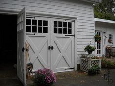 Maybe the world's MOST awesome garage doors ... maybe the most expensive, too?  I'm afraid to look.
