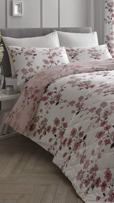 Add a floral burst to your bedroom with the Nadia blush duvet set. Crafted from a cotton rich polycotton material, the duvet set super cosy. Featuring a display of pink and grey cherry blossom flowers complete with delicate stems. The duvet set is designed with a reversible floral print on a pale pink background. Complete the look with the matching bedspread and curtains.