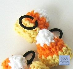 Candy Corn Amigurumi Hair Ties Free #crochet pattern and tutorial by SimplyCollectibleCrochet.com  Make the Candy Corn Amigurumi piece with the hair tie crocheted in so it will not slip out or to make them as decoration for a candy dish or window sill. These will make great party favors and last for years to come.