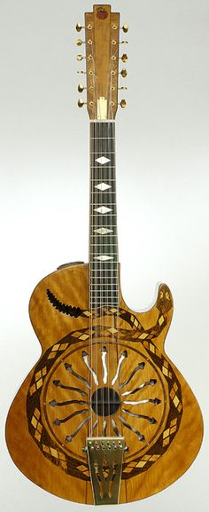 12 String Resonator - i think i'd die if i had to tune this thing. i DESPISE tuning. that's why i resent my uke a little.