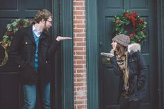 Lambertville Holiday Engagement- super cute posing idea for winter engagement photo session. Lambertville Holiday Engagement #engagementportraits #njphotographers #lambertville #holidayengagementphotos #gettingengagedduringtheholidays