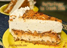This cake has a layer of graham cracker crust on the bottom, a layer of Butterfinger ice cream, Butterfinger crunchies in the middle, a layer of vanilla ice cream all covered in Whipped cream frosting and sprinkled with more Butterfingers.