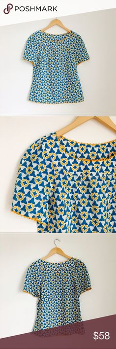 Tory Burch blouse Blue and yellow print blouse with short sleeves and yellow ricrac trim. Size 6. Cotton. Excellent condition. Tory Burch Tops