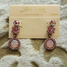 Kirk's Folly ~ dangling pierced Moon face Earrings Kirk's Folly,  NWOT,  signature KF Moon face in soft pink that appears to glow from within, face is surrounded by pink & aurora borealis crystals,  above the face is a cluster of crystals in the form of a flower, beautiful dangles with movement & style, arrive on the KF sales card Kirk's Folly  Jewelry Earrings
