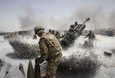US Army soldiers firing a Howitzer in Afghanistan | 32 Extremely Interesting Images!