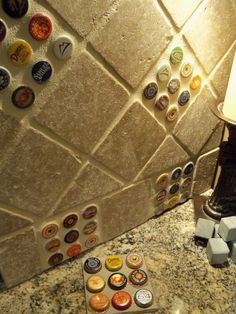 ok, so i haven't decided if I like this, but for someone who drinks I think it just might be kinda spiffy...and something the neighbors wouldn't have! I think I'm not 100% sold on it personally because I don't drink; otherwise I might just like it. :) -db. | Bottlecap backsplash tile. Basement bar?