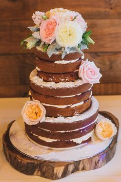 Rustic naked wedding cake with fresh flowers | Matthew Evans Photography | See more: http://theweddingplaybook.com/vintage-coastal-wedding/