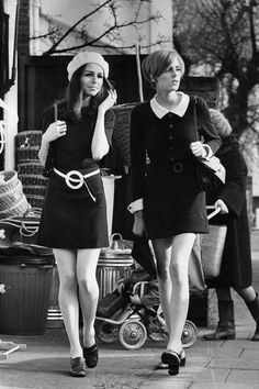 1968  Two young girls embrace the mod look while shopping in London.