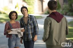 """The Vampire Diaries -- """"Black Hole Sun"""" -- Image Number: VD604a_0038.jpg -- Pictured (L-R): Kat Graham as Bonnie, Ian Somerhalder as Damon and Chris Wood as Kai (back to camera) -- Photo: Bob Mahoney/The CW -- © 2014 The CW Network, LLC. All rights reserved.pn"""