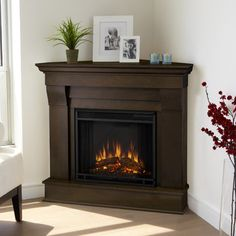 The Real Flame Chateau Corner Electric Fireplace is the perfect decoration for y… - Wood Burning Fireplace Inserts Gel Fireplace, Farmhouse Fireplace, Fireplace Design, Fireplace Ideas, Fireplace Cover, Limestone Fireplace, Black Fireplace, Small Fireplace, Corner Gas Fireplace