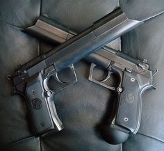 Cleric Pistols - Equilibrium.  Awesome movie. ...and now that I see them up close, I see that they are likely built on customized Beretta 92s. Cool picture.