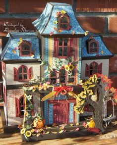 Sharalyn's Autumn Manor is simply divine!  The leaves on the trees have changed colors and have been falling and blowing around as you see them on the porch and on the roof!  Even one has landed on the darling seat of the swing!  Very creative!  MAPLE MANOR SVG KIT
