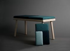 """""""Pusle"""" is a bench inspired by puzzle and the playfulness around old toys. It has a nordic expression, and stands out as a playful object with a lot of possibilities. It has cushions in different colors and sizes. You can add and change the cushions as you like, and use them to combine multiple benches. Choose the colors and combinations that suits you."""