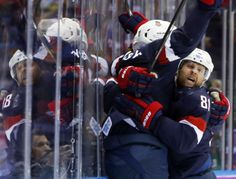 Sat-Sun at Sochi- Team USA celebrates a second period goal against Russia during a men's ice hockey game. trib.com/sports/winter-games