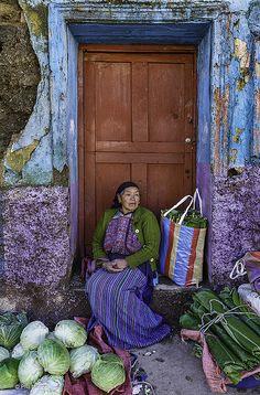 Woman selling banana leaves at Saturday market- Todos Santos , Guatemala by Phil Marion, via Flickr