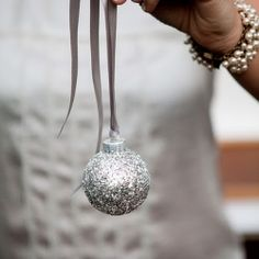 We have it! The perfect winter wedding favor: sparkling silver ornaments. Our DIY is oh-so simple.
