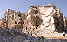 Damaged buildings are seen after an explosion ripped through the northern Syrian city of Aleppo