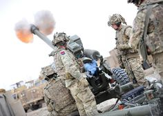 Troops from 97 (Lawson's) Battery 4th Regiment Royal Artillery fire smoke rounds to support soldiers on the ground near Patrol Base Attal in Helmand Province's Nahr-e Saraj district