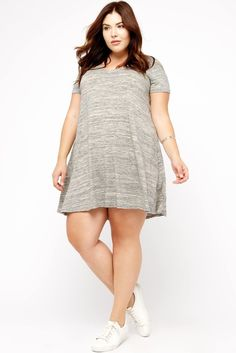 An easy-to-wear piece that's perfect for casual days, this t-shirt dress is made of lightweight slub-textured knit. It's finished with a v-neckline and short sleeves. Has a slight trapeze silhouette. Hemline hits at mid-thigh level. #PlusSizeFashion
