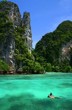 On your trip to Thailand, a visit to the majestic Phi Phi Islands is a must! There are many ways to visit the islands, with day trips available from both Phuket or Krabi. Plan your trip today! Thailand Beach, Thailand Travel, Oh The Places You'll Go, Places To Travel, Places To Visit, Vacation Destinations, Dream Vacations, Most Beautiful Beaches, Beautiful Places