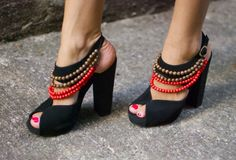 Add a few strings of beads to a pair of black heels to make these tribal-inspired heels.