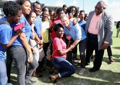 Prince Harry Photos Photos - Prince Harry meets school girls as he attends a youth sports festival at Sir Vivian Richards Stadium showcasing Antigua and Barbuda's national sports, on the second day of an official visit to the Caribbean on November 21, 2016 in Antigua, Antigua and Barbuda. Prince Harry's visit to The Caribbean marks the 35th Anniversary of Independence in Antigua and Barbuda and the 50th Anniversary of Independence in Barbados and Guyana. - Prince Harry Visits The Caribbean…