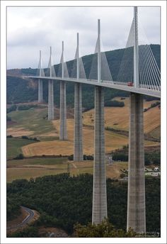 """World's Highest Bridge  French drivers put their cars into real """"high drive"""". Millau bridge is located in southern France, over the River Tarn in the Massif Central mountains  and is the highest bridge in the world. Its highest point is at 343m (1,125 ft),  with a vehicle height of 270m (885 ft) - taller than the Eiffel Tower! It is a truly amazing piece of engineering, especially considering the method used to span the distance between the piers."""