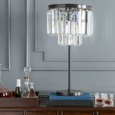 Add a stylish touch with this 28.75-inch crystal shaded contemporary lamp. Its iron base with brushed silver finish makes a chic in any room.…