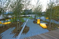 Built by StossLU in Milwaukee, United States with date 2010. Images by StossLU. Positioned on the edge of the Federal Channel and Lake Michigan, Erie Street Plaza by StossLU is a new public space t...