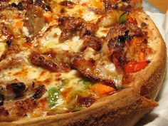 """Roadfood.com Portland Pie's Chamberlin topped with General Tso's sauce and pulled pork, plus red and green peppers, carrot twigs, toasted sesame seeds and three cheeses."""""""