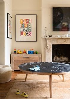 Kids' chlakboard table in the living room. Love the retro style of table - would be easy to do with a thrift store find.