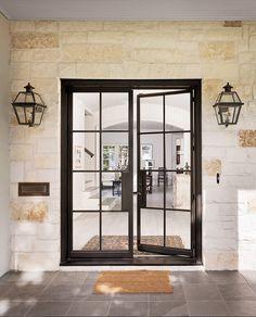 Black Steel Front Door. Front entry with black steel door, stone walls and…