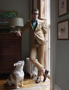 David Foxley {Assistant to Vanity Fair editor-in-chief Graydon Carter} + his English Bulldog Jack // Wearing a cotton gabardine suit from Rugby in his West Village apartment