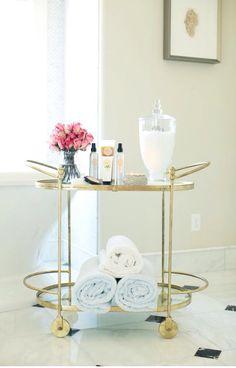 Gold bar cart in bathroom