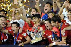 Top sports stories in China for 2013- #1.  Guangzhou Evergrande became the first Chinese club to win the AFC Champions League, as the Chinese champions secured the title on away goals after a 3-3 aggregate draw with FC Seoul in the final.   Head coach Marcello Lippi made history by becoming the first to win Champions Leagues in both in Europe and Asia. In the year-end FIFA Club World Cup, debutant Guangzhou beat African champions
