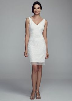 Sparkling all over beaded detailing on this exquisite mesh dress will dazzle and shine all night long!  Sleeveless all over beaded tank bodice features deep v-neckline and back.  Available in White online and in select stores.  Fully lined. Imported polyester. Spot clean only.  To protect your dress, try our Non Woven Garment Bag.