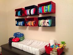 Clothing diaper storage on the wall.. So Ryleigh can't pull them onto the floor!