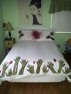 I don't know what's cooler:  the zombie apocalypse bedding or the Audrey Hepburn print in the background