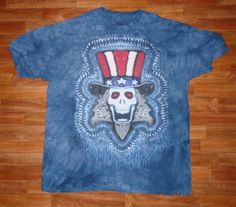This is a printed version of my Uncle Sam Design. The original goes for $100.00, because it takes about six hours to prepare for dye, but thanks to the water based jet print technique designed by The Mountain Corporation, of Keene New Hampshire, I am able to sell these prints for $25.00      Wholesale inquiries are welcome~