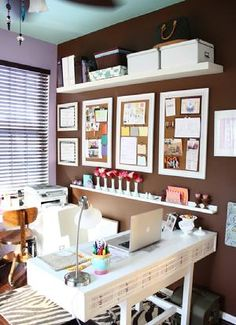 Love this office space. #decor It's a bit cluttery for me, but the shelves are a definite must.