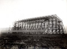 Cardington airship shed under construction with steel framing half complete 12 December 1916. One of a set of photographs to accompany a paper by T. M. Rounthwaite; 'The Royal Naval Air Works, Cardington, Bedford, with some notes on their construction'  which was read before the ICE Newcastle-upon-Tyne local association 27 February 1922 (ref 0C4453