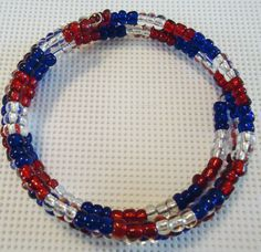 Red \, white and blue memory wire bracelet I made. For sale on Etsy $8.00