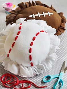 Turn a little bit of fleece, shoe laces and some batting into these adorable sporty pillows! Have your kids help you make them for their cousins or friends! #ParentsGifts #ParentsMagazine