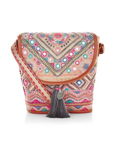 Make like a global traveller with our Souk across-body bag, decorated with mirrorwork embellishments, woven patterns and leather-look trims. It has a flap-over front with tassel charms plus an adjustable shoulder strap.