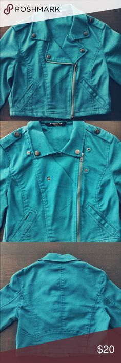 Cropped Moto Jacket Super cool cropped Moto jacket with pewter fastenings! It can be worn zipped all the way up, or zipped half way. The color is a rich teal - more saturated than how it shows in the picture. Celebrity Pink Jackets & Coats