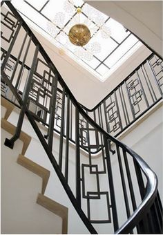 Deco Staircase with skylight and modern chandelier