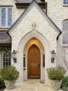 .European style home: Stone facade of white and light golden sand coloring. Architecture has  vertical emphasis in all proportions. (a relaxed, contemporary version of Gothic)